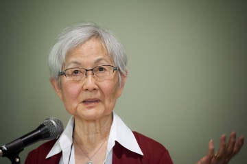 Mary Kitagawa speaks at the Addressing Injustice symposium in March 2012. Photo by Don Erhardt
