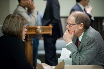 David Farrar, Provost and Vice President, Academic at UBC, engaged in conversation with an audience member Vivian Rynestad at the Addressing Injustice symposium . Photo by Don Erhardt